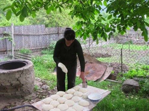 Host mother Marina making bread